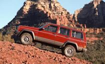 <p>Introduced for the 1984 model year, the Cherokee was a revelation: a rugged, solid-axle off-roader that was nonetheless refined enough to serve as a family hauler. Its tidy dimensions, lightweight unibody construction, and handsomely upright styling (credited to Richard Teague) were beloved by buyers who wanted 4x4 capability without the compromises inherent to big, heavy, truck-based brutes. The Cherokee's intended replacement, the Jeep Grand Cherokee, arrived in 1993, but the hot-selling XJ soldiered on until 2001, undergoing only one mild facelift in 1997 that left all the underlying sheetmetal entirely unchanged. </p>
