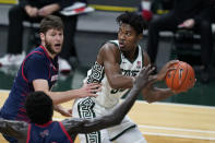 Michigan State forward Julius Marble II (34) looks to pass as Detroit Mercy forward Willy Isiani defends during the first half of an NCAA college basketball game, Friday, Dec. 4, 2020, in East Lansing, Mich. (AP Photo/Carlos Osorio)
