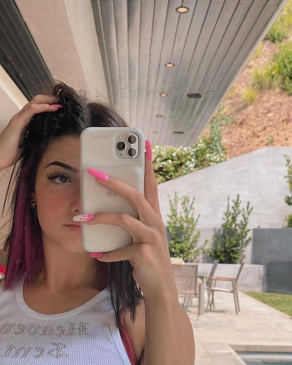 "<p>After about a <a href=""https://www.seventeen.com/beauty/celeb-beauty/a33484451/charli-damelio-blue-hair/"" rel=""nofollow noopener"" target=""_blank"" data-ylk=""slk:week with blue hair"" class=""link rapid-noclick-resp"">week with blue hair</a>, Charli is changing up her lob yet again. She revealed a new, fiery fuchsia streak that perfectly coordinates with her bubblegum claws. I'm living for it, tbh.</p>"