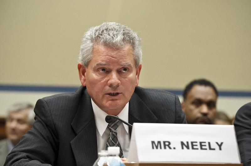 Appearing before the House Committee on Oversight and Government Reform, former GSA official Jeff Neely declines to answer questions at a hearing about wasteful spending and excesses at a Las Vegas conference, on Capitol Hill in Washington, Monday, April 16, 2012. Neely, formerly the regional commissioner of the Public Buildings Service, Pacific Rim Region, was ordered to leave the witness table after invoking his rights to not testify on the advice of his counsel. (AP Photo/J. Scott Applewhite)