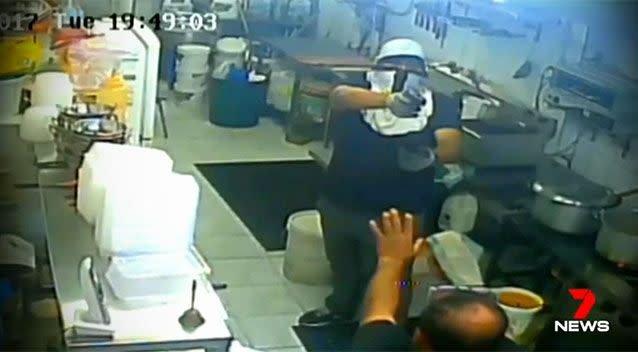The robbery was caught on CCTV footage inside the restaurant. Photo: 7 News