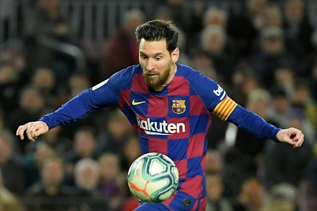 Lionel Messi's Barcelona lead La Liga by two points with 11 rounds of the seasons to go (AFP Photo/LLUIS GENE)