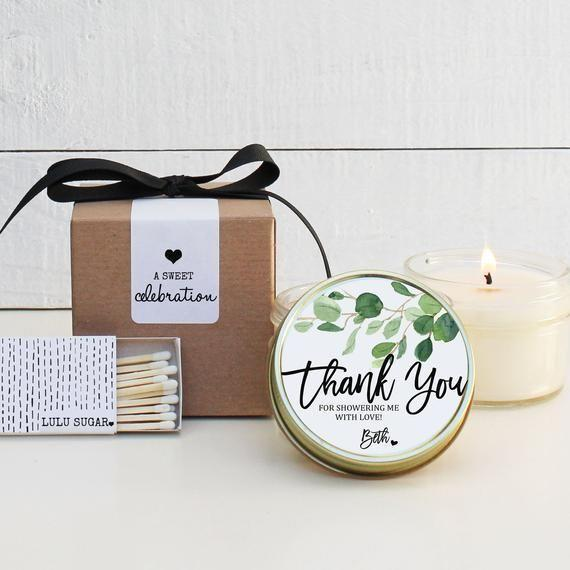 """<p><strong>lulusugar</strong></p><p>etsy.com</p><p><strong>$7.00</strong></p><p><a href=""""https://go.redirectingat.com?id=74968X1596630&url=https%3A%2F%2Fwww.etsy.com%2Flisting%2F666097240%2Fbridal-shower-favors-bridal-shower&sref=https%3A%2F%2Fwww.countryliving.com%2Fentertaining%2Fg27396315%2Fbridal-shower-favor-ideas%2F"""" rel=""""nofollow noopener"""" target=""""_blank"""" data-ylk=""""slk:Shop Now"""" class=""""link rapid-noclick-resp"""">Shop Now</a></p><p>Who doesn't love candles? No matter how many your guests have, they'll welcome another. This one features a gorgeous eucalyptus design and a variety of lid metals to choose from.</p>"""