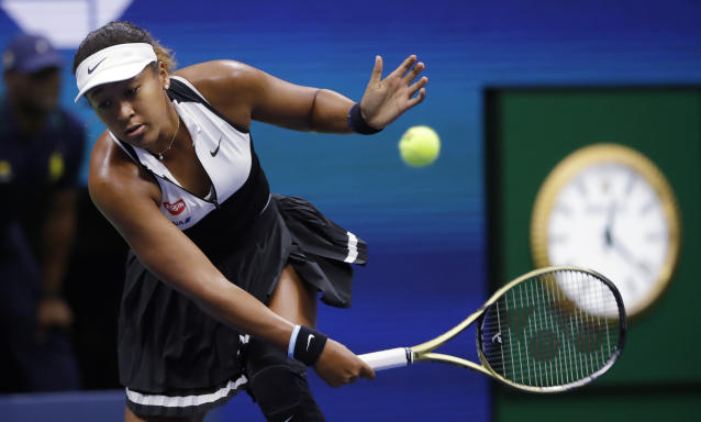 Naomi Osaka, of Japan, returns against Belinda Bencic, of Switzerland, during the fourth round of the US Open tennis championships Monday, Sept. 2, 2019, in New York. (AP Photo/Frank Franklin II)