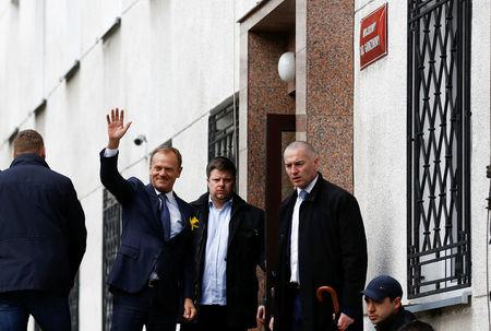 Donald Tusk, the President of the European Council waves as he arrived at the prosecutor office in Warsaw, Poland April 19, 2017. REUTERS/Kacper Pempel