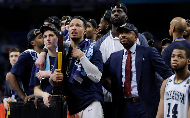 Villanova players watch the screen as they celebrate after the championship game of the Final Four NCAA college basketball tournament against Michigan, Monday, April 2, 2018, in San Antonio. Villanova won 79-62. (AP Photo/David J. Phillip)