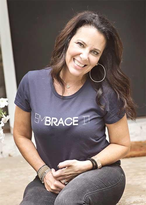 Lainie wearing her EmBRACE It t-shirt.