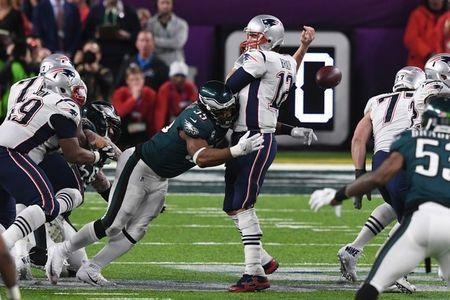 Feb 4, 2018; Minneapolis, MN, USA; Philadelphia Eagles defensive end Brandon Graham (55) sacks New England Patriots quarterback Tom Brady (12) to fumble the ball in the fourth quarter in Super Bowl LII at U.S. Bank Stadium. John David Mercer-USA TODAY Sports