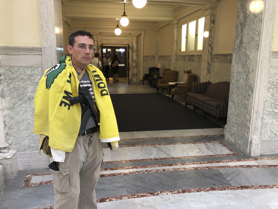 Allen Clark of Meridian, Idaho, attends the opening of the Idaho special session at the Statehouse in Boise, Idaho, on Monday, Aug. 24, 2020. He said he was among the crowd that forced their way into the gallery for the House of Representatives that had initially been limited due to the coronavirus pandemic. (AP Photo/Keith Ridler)
