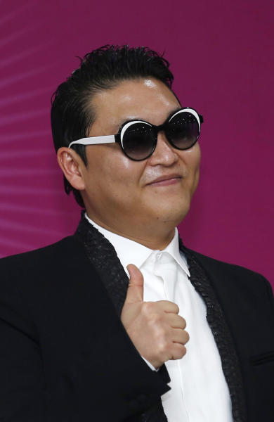 "South Korean rapper PSY poses during a news conference for his concert ""Happening"" in Seoul, South Korea Saturday, April 13, 2013. PSY is unveiling the music video and choreography for his new single ""Gentleman"" at the Seoul concert. (AP Photo/Kin Cheung)"
