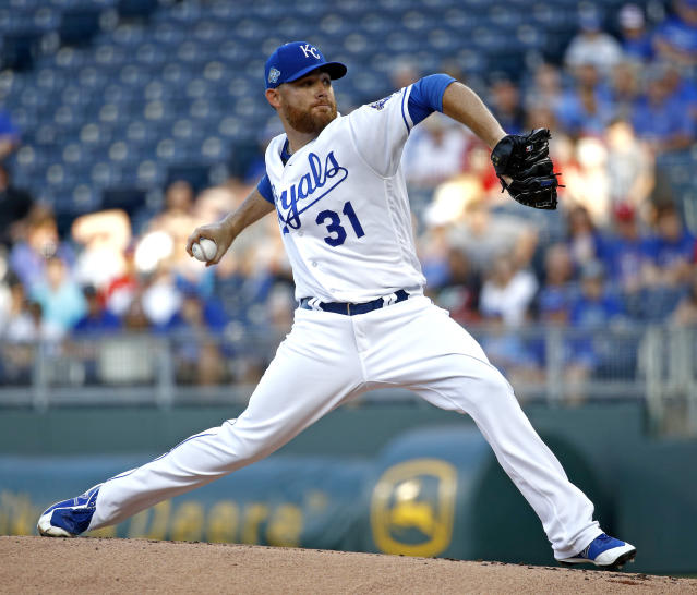 Kansas City Royals starting pitcher Ian Kennedy throws during the first inning of a baseball game against the Texas Rangers Monday, June 18, 2018, in Kansas City, Mo. (AP Photo/Charlie Riedel)