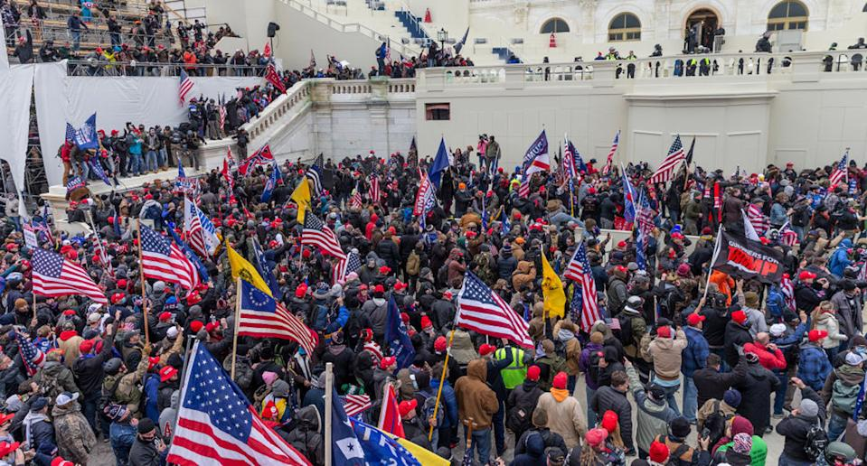 Pro-Trump protesters seen on and around Capitol building. Source: Getty Images