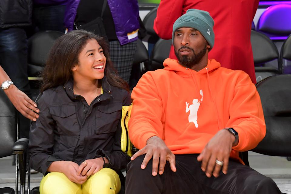 Kobe Bryant and daughter Gianna Bryant attend a basketball game between the Los Angeles Lakers and the Dallas Mavericks at Staples Center on December 29, 2019 in Los Angeles, California. (Photo by Allen Berezovsky/Getty Images)