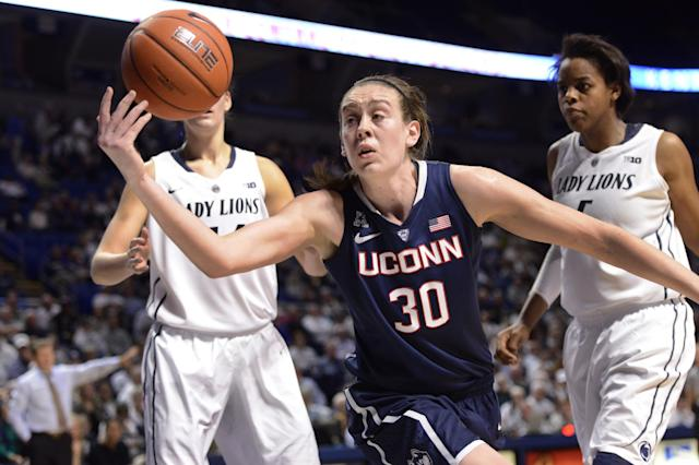Connecticut's Breanna Stewart (30) goes after a loose ball in the second half of an NCAA college basketball game on Sunday, Nov. 17, 2013, in State College, Pa. Penn State's Talia East, right, and Tori Waldner, left, look on. Connecticut won 71-52. (AP Photo/John Beale)