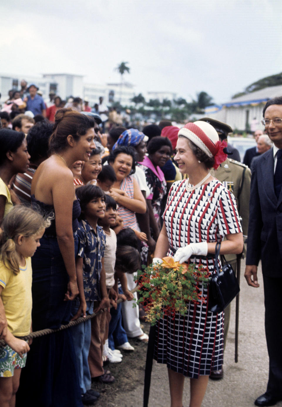 Queen Elizabeth II on a walkabout in Bridgetown, Barbados, during her Silver Jubilee tour of the Caribbean.