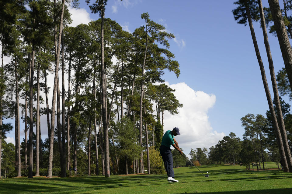 Tiger Woods tees off on the 17th hole during a practice round for the Masters golf tournament Monday, Nov. 9, 2020, in Augusta, Ga. (AP Photo/David J. Phillip)