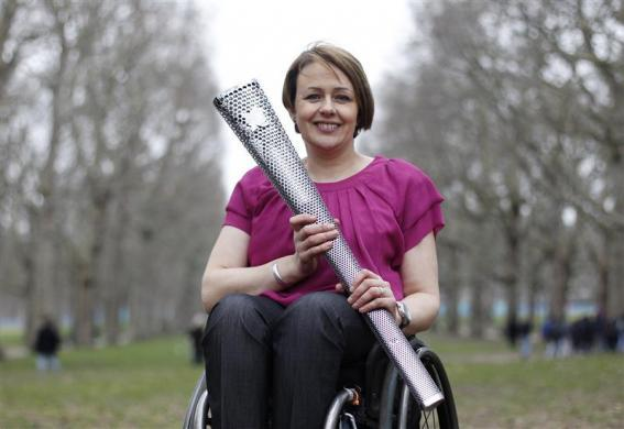 Baroness Tanni Grey-Thompson from Wales, one Great Britain's most successful disabled athletes; poses with the torch which will be used for the 2012 Paralympic Games in Green Park, central London, February 29, 2012.