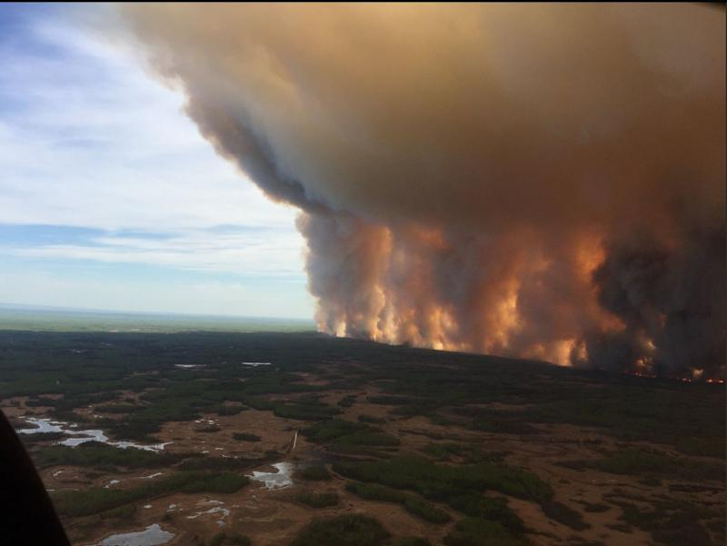 Thousands of people are being told to leave High Level, as well as the Bushe River Reserve, via Highway 58 east of the communities since highways south and west have already been closed due to the blaze. (Rob Drinkwater/The Canadian Press)