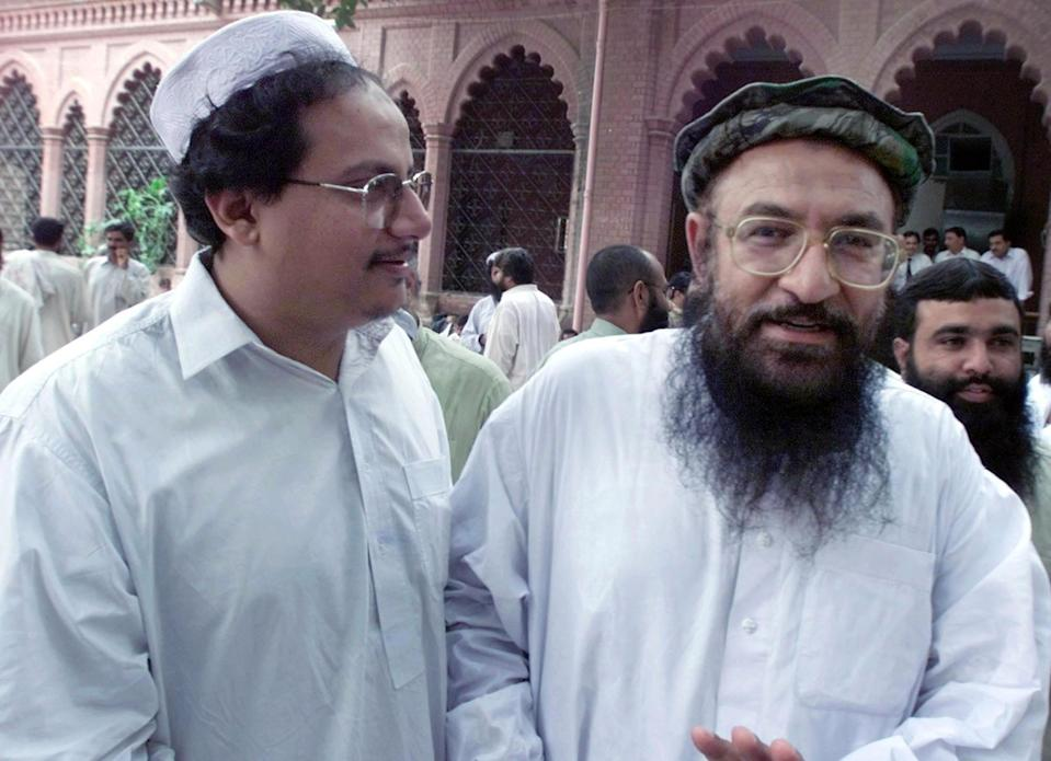 Talha Saeed (L) son of Hafiz Saeed along with Abdur Rehman Makki (R) at the Lahore High Court on July 31, 2002. (AP Photo/str)