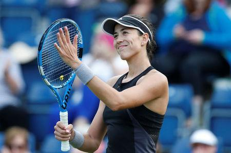 Tennis - WTA Premier - Nature Valley Classic - Edgbaston Priory Club, Birmingham, Britain - June 19, 2018 Spain's Garbine Muguruza celebrates winning her first round match against Russia's Anastasia Pavlyuchenkova Action Images via Reuters/Ed Sykes