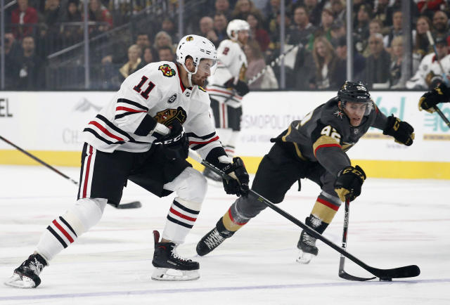Chicago Blackhawks left wing Brendan Perlini (11) vies for the puck with Vegas Golden Knights left wing Tomas Nosek (92) during the first period of an NHL hockey game Thursday, Dec. 6, 2018, in Las Vegas. (AP Photo/John Locher)