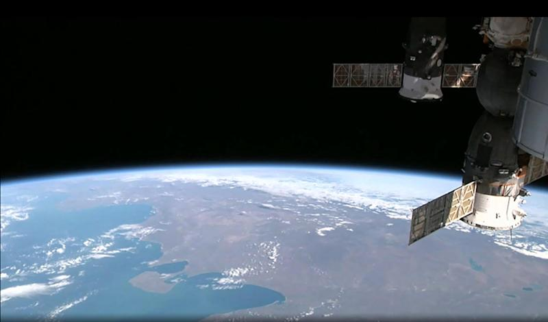 This August 12, 2014 NASA image from video taken by High Definition Earth Viewing experiment aboard the ISS, mounted on the External Payload Facility of the European Space Agency's Columbus module, shows the International Space Station