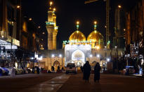 Shiite faithful pilgrims visit the shrine of Imam Moussa al-Kadhim in Baghdad, Iraq, despite a curfew imposed by the government to help fight the spread of the coronavirus, Saturday, Feb. 20, 2021. Mosques and schools are closed, large gatherings prohibited, and the wearing of masks and other protective gear will be enforced, according to a statement from the government. (AP Photo/Hadi Mizban)