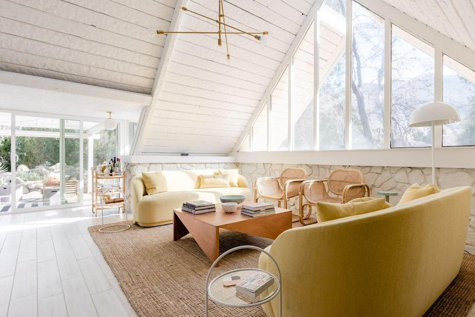 """<p>Ten minutes from downtown Palm Springs, California, this A-frame house has all the playful chic you would expect of a home owned by the trio of founders of the <a href=""""https://www.instagram.com/echoandearl/?hl=en"""" rel=""""nofollow noopener"""" target=""""_blank"""" data-ylk=""""slk:Echo and Earl"""" class=""""link rapid-noclick-resp"""">Echo and Earl</a> creative agency, including the photographer and interior designer Caroline Lee. The public spaces are flooded with light, the palette is sherbet-soft, and the private pool and outdoor patio are ideal for sun worshipping and stargazing.</p><p><a class=""""link rapid-noclick-resp"""" href=""""https://www.airbnb.com/rooms/plus/40800284"""" rel=""""nofollow noopener"""" target=""""_blank"""" data-ylk=""""slk:Book Now"""">Book Now</a></p>"""