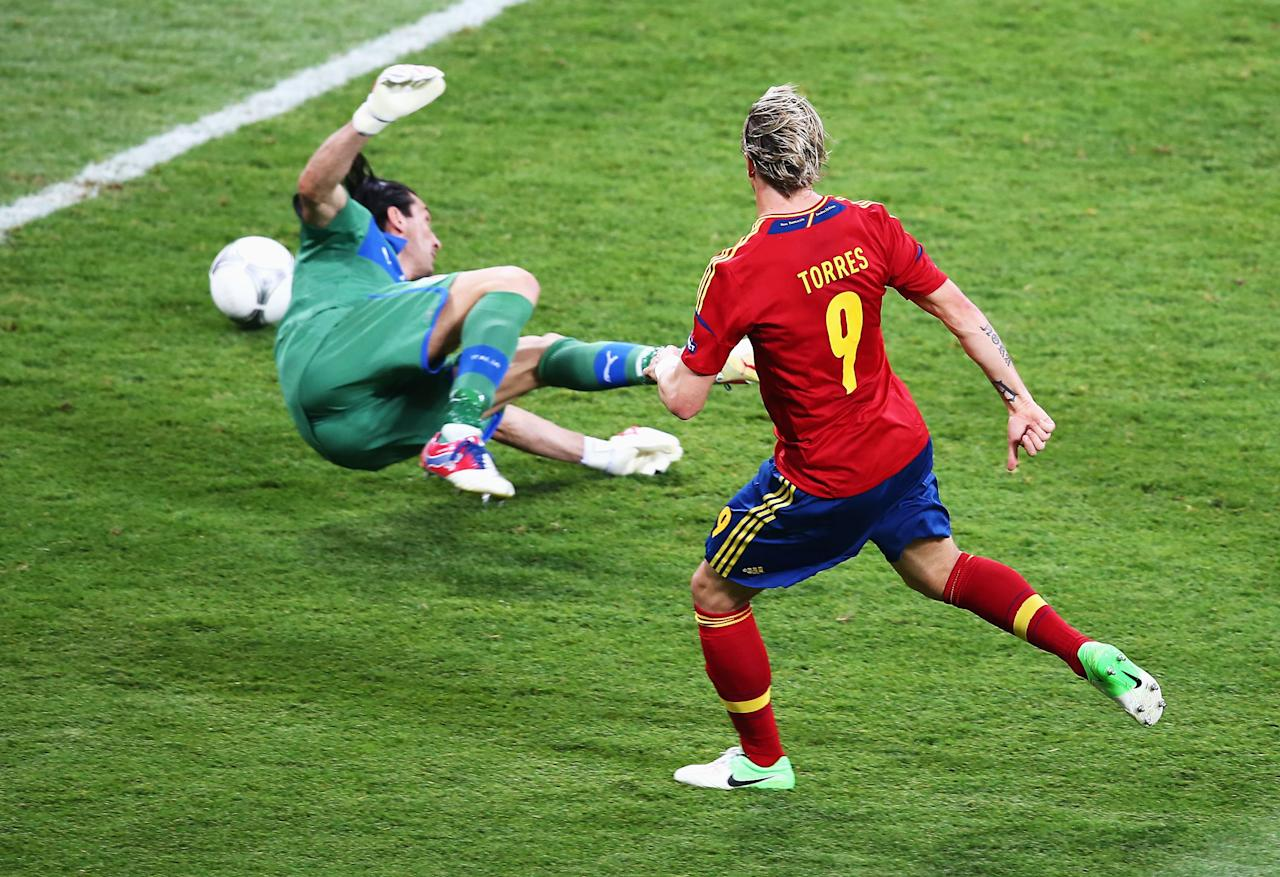 KIEV, UKRAINE - JULY 01:  Fernando Torres of Spain scores his side's third goal past Gianluigi Buffon of Italy during the UEFA EURO 2012 final match between Spain and Italy at the Olympic Stadium on July 1, 2012 in Kiev, Ukraine.  (Photo by Martin Rose/Getty Images)