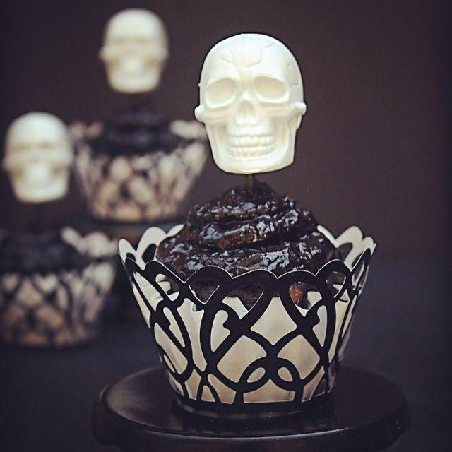 """<p>Use some themed cake toppers to make your cakes look uber professional without much added effort. </p><p><a class=""""link rapid-noclick-resp"""" href=""""http://www.meandannabellee.com/halloween-skull-cupcakes/"""" rel=""""nofollow noopener"""" target=""""_blank"""" data-ylk=""""slk:GET THE RECIPE"""">GET THE RECIPE</a></p><p><a href=""""https://www.instagram.com/p/BZW6EIJlOT6/"""" rel=""""nofollow noopener"""" target=""""_blank"""" data-ylk=""""slk:See the original post on Instagram"""" class=""""link rapid-noclick-resp"""">See the original post on Instagram</a></p>"""