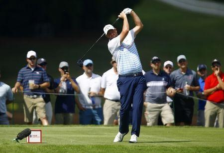 FILE PHOTO: Sep 21, 2018; Atlanta, GA, USA; Marc Leishman tees off on the fourth hole during the second round of the Tour Championship golf tournament at East Lake Golf Club. Mandatory Credit: Butch Dill-USA TODAY Sports