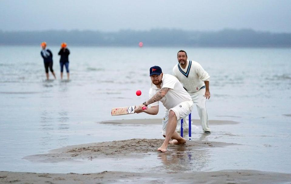 Members of the Royal Southern Yacht Club and the Island Sailing Club take part in the annual Brambles cricket match between the clubs (Andrew Matthews/PA) (PA Wire)