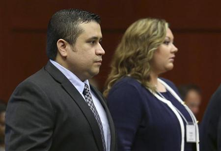 George Zimmerman with his wife Shellie arrives in Seminole circuit court in Sanford,
