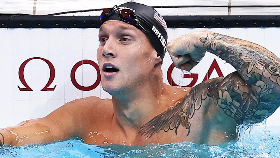 US star Caleb Dressel flexes after winning the 100m butterfly final at the Tokyo Oympics.