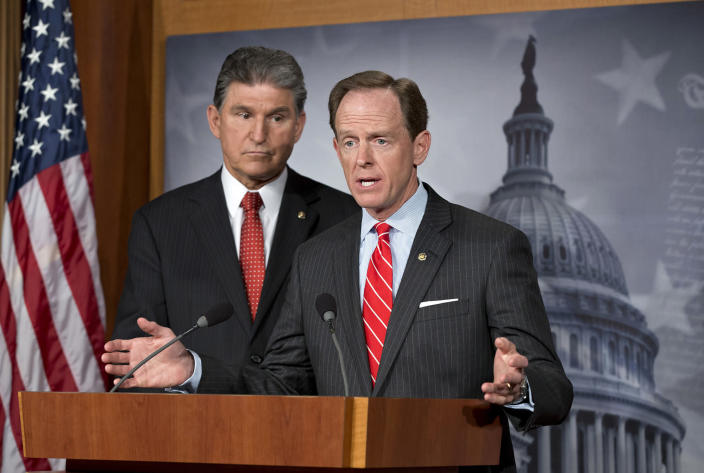 Democratic Sen. Joe Manchin of West Virginia, left, and Republican Sen. Patrick Toomey of Pennsylvania announce that they have reached a bipartisan deal on expanding background checks to more gun buyers, at the Capitol in Washington in April 2013. (Photo: J. Scott Applewhite/AP)
