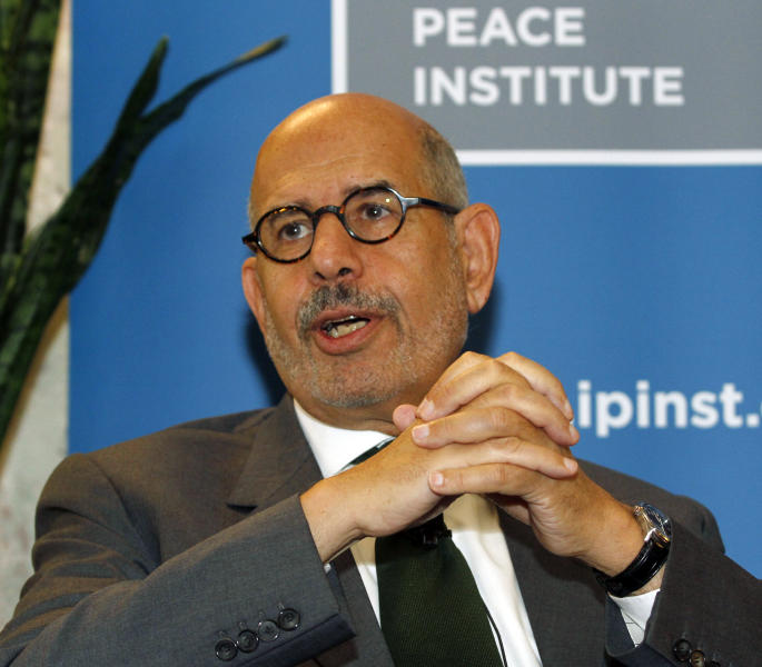"""Former Director General of the International Atomic Energy Agency, IAEA, and Nobel Peace Prize winner Mohamed El Baradei smiles as he speaks to the media in Vienna, Austria, Thursday May 24, 2012. As Egyptians chose their first democratically elected president, reform leader ElBaradei says who wins is less important than establishing national unity. He told The Associated Press that choice between reformist, Islamist or pragmatist pales behind getting Egyptians to agree """"on the basic common values that they're going to live under."""" (AP Photo/Ronald Zak)"""