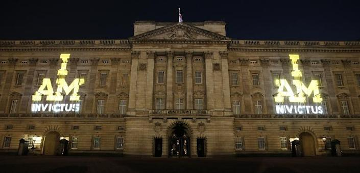The Invictus Games logo is projected onto Buckingham Palace in central London, on September 9, 2014 (AFP Photo/Jonathan Brady)