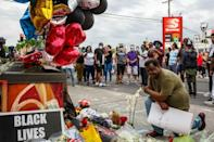 People left flowers and balloons at a makeshift memorial for George Floyd who died in police custody on May 26, 2020 in Minneapolis