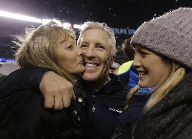 Seattle Seahawks head coach Pete Carroll, center, celebrates after the NFL Super Bowl XLVIII football game against the Denver Broncos Sunday, Feb. 2, 2014, in East Rutherford, N.J. The Seahawks won 43-8. (AP Photo/Jeff Roberson)
