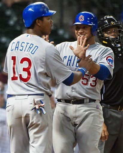 Chicago Cubs' Starlin Castro (13) and Welington Castillo (53) celebrate after scoring on a double by Dave Sappelt during the seventh inning of a baseball game against the Houston Astros, Monday, Sept. 10, 2012, in Houston. (AP Photo/Dave Einsel)