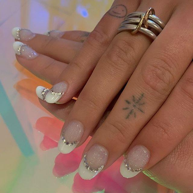 """<p>Amp up a classic French manicure by using a glittery base and adding some crystal decals along the tip for maximum glitz. </p><p><a class=""""link rapid-noclick-resp"""" href=""""https://www.amazon.com/TecUnite-Crystals-Rhinestones-Rhinestone-Organizer/dp/B07CTLWJJF/?tag=syn-yahoo-20&ascsubtag=%5Bartid%7C10055.g.1267%5Bsrc%7Cyahoo-us"""" rel=""""nofollow noopener"""" target=""""_blank"""" data-ylk=""""slk:SHOP NAIL CRYSTALS"""">SHOP NAIL CRYSTALS</a></p><p><a href=""""https://www.instagram.com/p/CCrrsjcAx8t/&hidecaption=true"""" rel=""""nofollow noopener"""" target=""""_blank"""" data-ylk=""""slk:See the original post on Instagram"""" class=""""link rapid-noclick-resp"""">See the original post on Instagram</a></p>"""