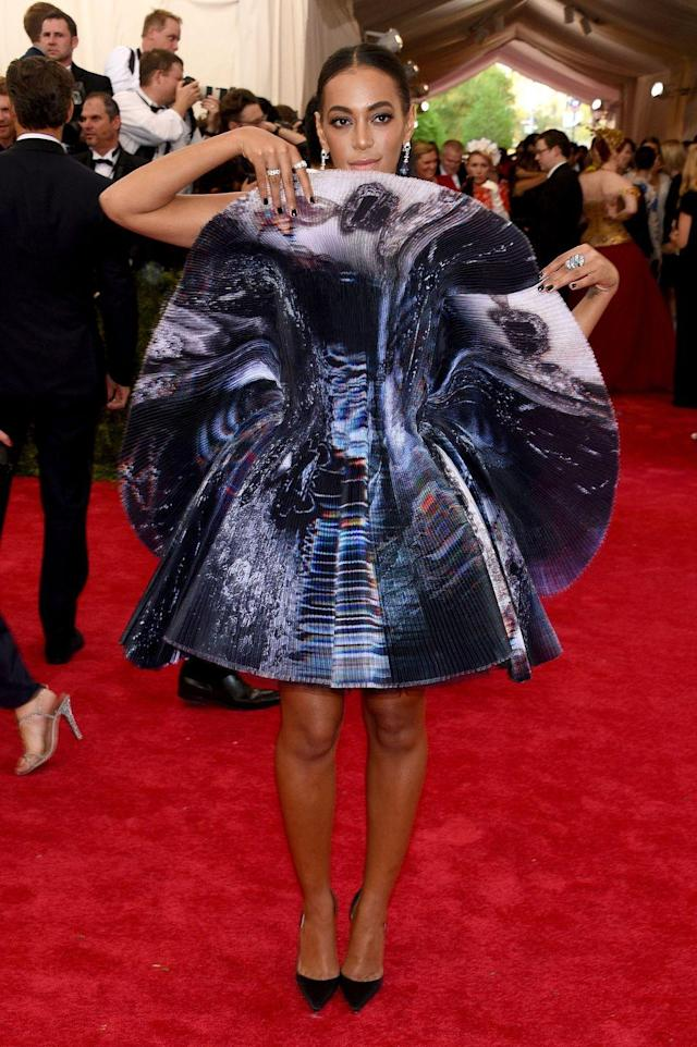 <p>That same year Solange wore an optical illusion gown from the Fall/Winter 2015 collection by the English brand Giles. The fine pleats and print gave the mirrored mini a reflective look. Finishing off the look, the singer-songwriter completed everything with a set of Cartier jewels. </p>