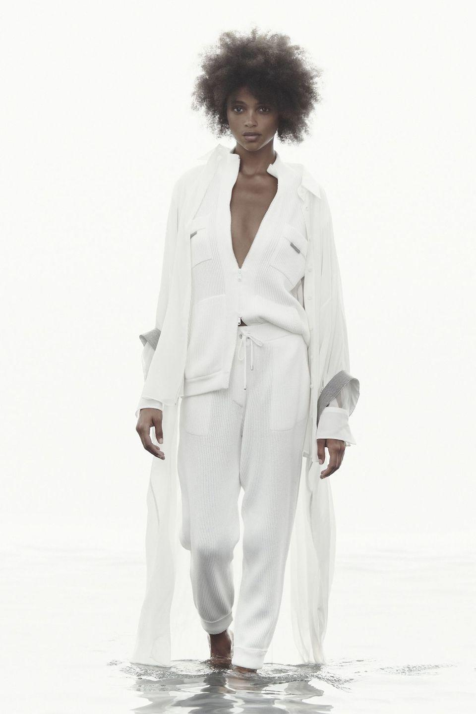 <p>Elevated basics with a focus on special details is the hallmark of cashmere king Brunello Cucinelli, and the designer drove this point home for spring 2021. He presented a collection titled Pure Spirit that focused on relaxed silhouettes, soft colors, and interplay of textures. A gilded leather coat adds a glam finish to a humble fisherman sweater, while a macramé top—featuring precious sequin yarns and irregular jute ropes knotted together—peeks out from underneath an easy linen suit. Even cozy knit sweats paired with a flowing silk robe are given the royal treatment. Through each elegantly understated ensemble, Cucinelli proves that there's beauty in simplicity. —<em>Barry Samaha</em>. </p>