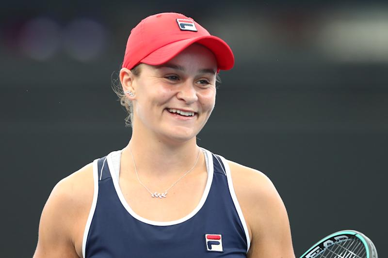 Ashleigh Barty smiles while partnered with Kiki Bertens of the Netherlands in the doubles finals match against Hsieh Su-wei and Strycova Barbora.