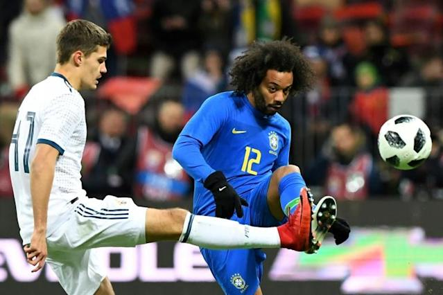 Russia's midfielder Roman Zobnin (L) and Brazil's defender Marcelo vie for the ball during an international friendly football match in Moscow (AFP Photo/Kirill KUDRYAVTSEV)