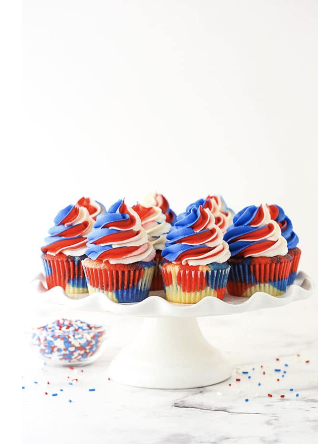 """<p>It's actually easy to make this eye-catching dessert: Divide your cupcake batter into three bowls, keep one plain, dye one red, and dye the other one blue, then dollop them into cupcake liners and bake!</p><p><em><a href=""""https://www.lifeloveandsugar.com/red-white-and-blue-swirl-cupcakes/"""" rel=""""nofollow noopener"""" target=""""_blank"""" data-ylk=""""slk:Get the recipe from Life, Love & Sugar »"""" class=""""link rapid-noclick-resp"""">Get the recipe from Life, Love & Sugar »</a></em></p>"""