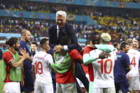 Switzerland's manager Vladimir Petkovic celebrates with his players end of the Euro 2020 soccer championship round of 16 match between France and Switzerland at the National Arena stadium, in Bucharest, Romania, Tuesday, June 29, 2021. (Marko Djurica/Pool Photo via AP)