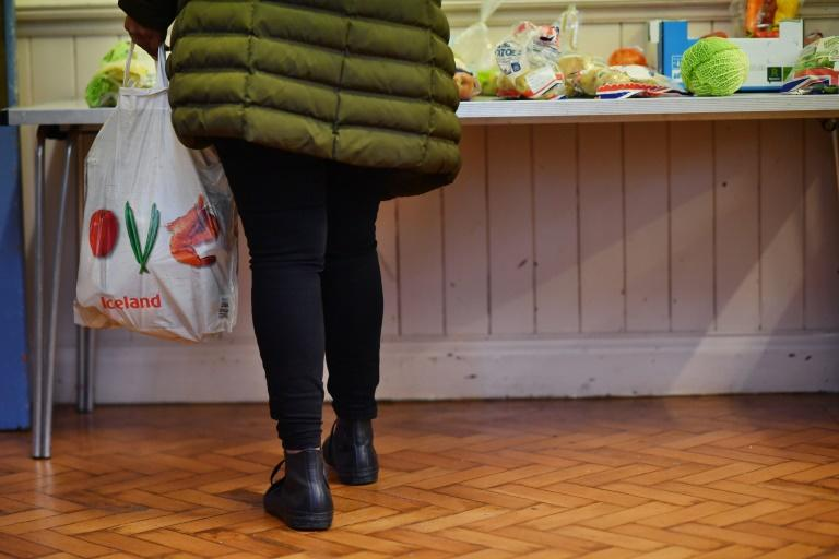 Access to food banks is granted via referrals from care professionals like doctors and social workers, who issue vouchers (AFP Photo/BEN STANSALL)