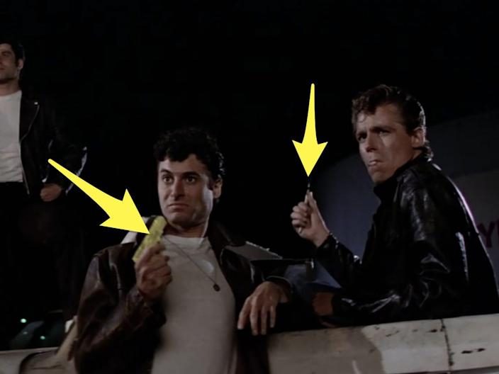 one t-bird holding a water gun and another t-bird holding a knife