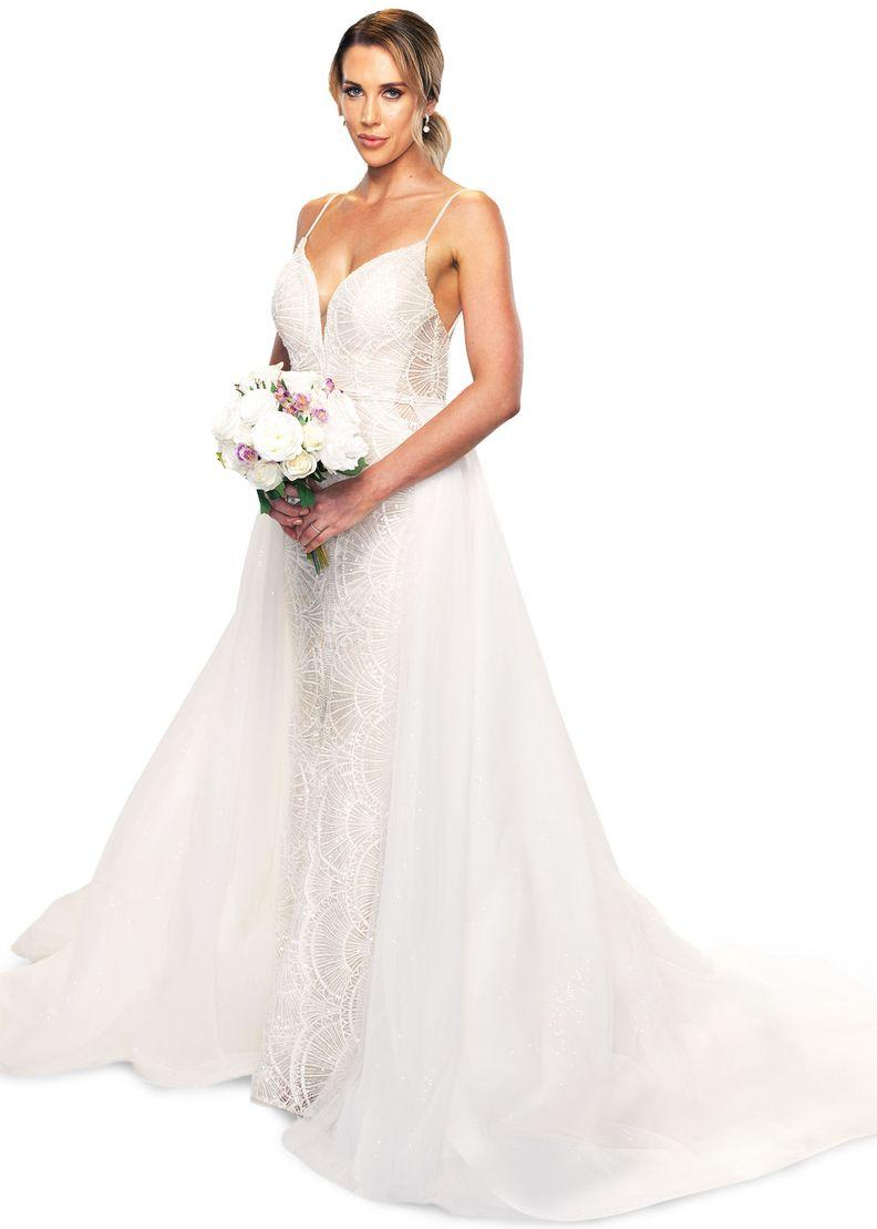 Married At First Sight 2021 bride Bec Zemek wearing a wedding dress and holding a bouquet